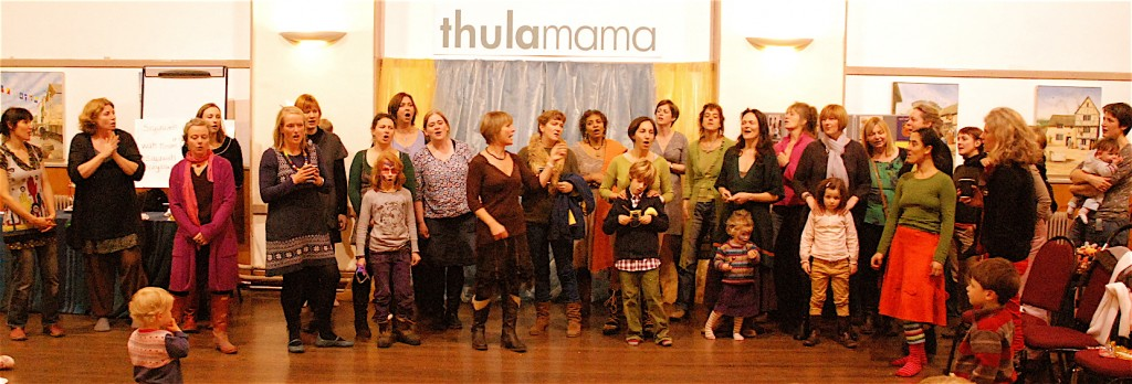 Helen teaching a song at the Thula Mama 10th anniversary party in Totnes, November 2012.