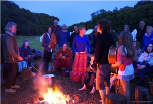 Singing by firelight at Rise Up Singing.