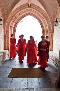 The girls enter Dartington Hall to sing at Home Festival